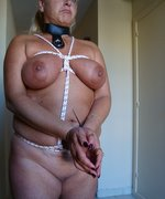 Mature slut in strict rope bondage