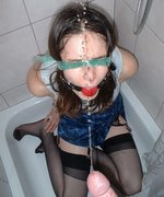 Pretty slave is bound, gagged and blindfolded in the shower before being used as a human toilet