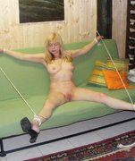Older woman is tied, spread and fingered