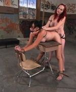 Berlin gets Daisy to the Twisted Factory classroom to teach her some S&M games. Slutty Daisy's shirt is ripped open to reveal her full breasts, her panties are stuffed in her mouth, and clamps are applied to her tits
