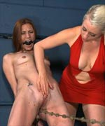 "Lorelei heats up Delilah's cunt. Being ordered to walk a crotch-rope is punishment enough for most bitches but Lorelei adds ""icy-hot"" to the rope creating a painful pussy experience"