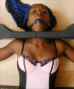 Bondage virgin Lexy is put into heavy, solid restraint and stock system by Mistress January