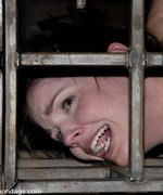 Bobbi Starr gagged, punished and fucked in iron cage bondage