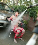Busty MILF Sara Stone get sprayed down with cum and a hose!