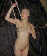 Elegant asian slave Kumi is bound up and hung from the rafters