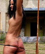 Serious outdoor drill for a totally nude young female under very strong whip lashes on her sweating skin!
