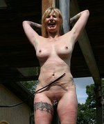 Blonde amateur has to endure ultra strong whipping lashes and water pain outdoor!