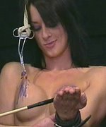 Slave is clamped, whipped and cruelly burned with wax