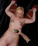 Blonde slave is tied spread on the cross while hotwax is poured over her tiny tits