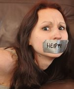 Pretty teen bound and gagged on the sofa